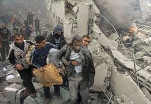 Gallery Gaza air strikes: An injured Palestinian prisoner is helped