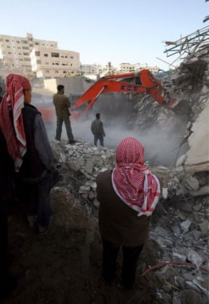 Gallery Gaza air strikes: Palestinians search for bodies in the rubble of the Hamas security compound
