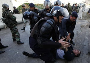 Gallery Gaza air strikes: Lebanese policemen during a riot in front of the Egyptian embassy