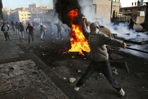 Gallery Gaza air strikes: A Palestinian protester throws stones at Israeli troops