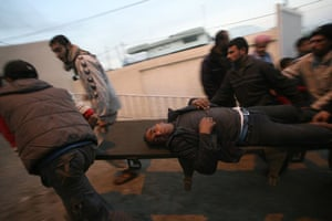 Gallery Gaza air strikes: A wounded Palestinian man is carried into a hospital in Rafah