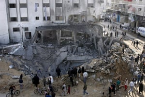 Gallery Gaza air strikes: Palestinians pass by the Alshefaa mosque after it was hit