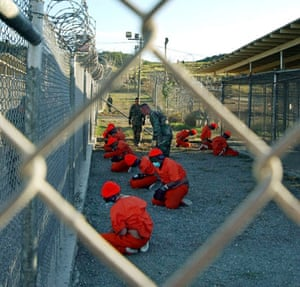 Gallery Guantanamo: Taliban and al-Qaida detainees sit in a holding area at Camp X-Ray