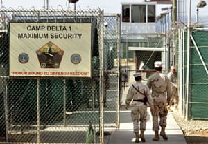 Gallery Guantanamo: U.S. military guards walk inside Camp Delta