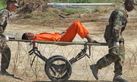 A detainee from Afghanistan is carried on a stretcher at Guantanamo Bay