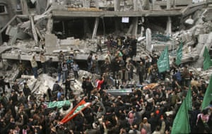 Gallery Funeral in Gaza: Mourners carry the bodies of five members of the Balosha family