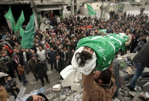 Gallery Funeral in Gaza: A relative carries the body of Dena Balosha during her funeral