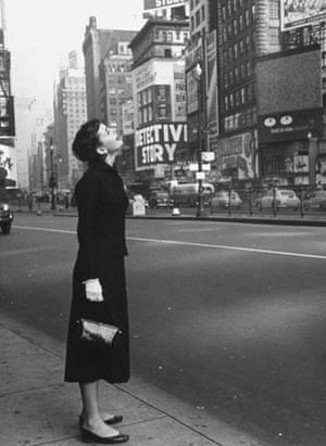Gallery 1951: Audrey Hepburn looks up at billboards in middle of Times Square