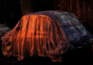Gallery 24 hours in pictures: A plastic cover protects an old Fiat Cinquecento