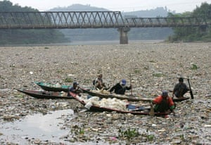 Gallery River Citarum : Indonesian men collect plastic rubbish for recycling on the Citarum river