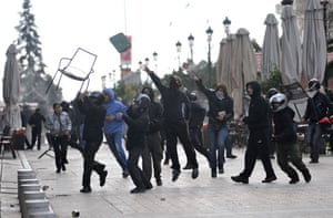 Gallery Riots in Athens: Protesters throw missiles at riot police during clashes in Thessaloniki
