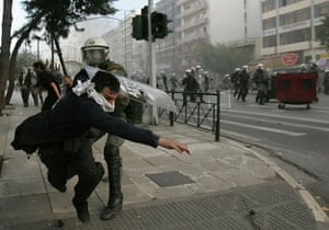 Gallery Riots in Athens: Youths clash with riot police in Athens