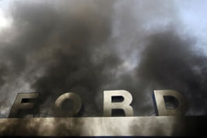 Gallery Riots in Athens: A Ford car dealership burns as youths clash with riot police  in Athens