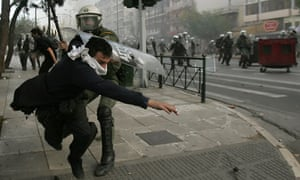 Youths clash with riot police  in Athens
