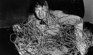 Man tangled up in wires or computer cables