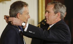 George Bush presents Tony Blair with a presidential medal of freedom