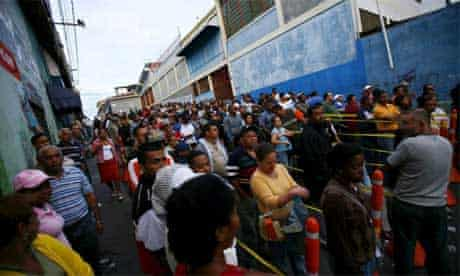 Voters wait at a polling station in Caracas, Venezuela