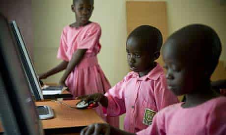 Pupils from Katine primary school, in Uganda, are trained to use computers in the community media centre in the sub-county