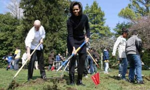 Michelle Obama joins students from Bancroft Elementary School during a groundbreaking ceremony for the new White House Kitchen Garden in Washington. Photograph: Jason Reed/Reuters