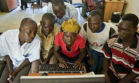 A basic computing training class in the community media room at Amref's Katine office.