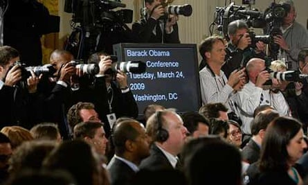 Members of the media stand around just before Barack Obama's primetime news conference