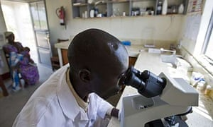 Elias Oluja, lab technician from Tiriri health centre tests patients for HIV during his weekly visit to the lab at the Ojom health centre, Katine