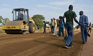 Workers under the supervision of Chinese contractors resurface the Lira road, Katine