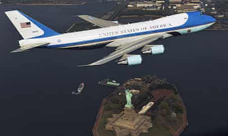 The jet that serves as Air Force One flies over the Statue of Liberty in New York on 27 Apri