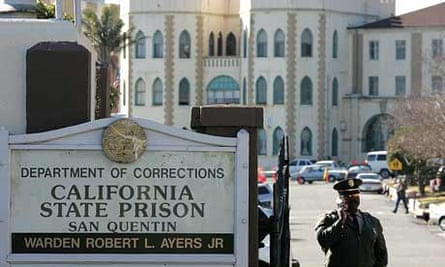 A guard stands at the entrance to the California state prison at San Quentin