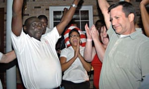 Mayoral candidate James Young, left, and supporters celebrate as his campaign claimed the win on election night