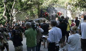 Media and fans gather near the home of pop star Michael Jackson in Los Angeles.