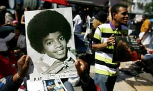 A fan holds an autographed photo of Michael Jackson at the Apollo theatre in New York.