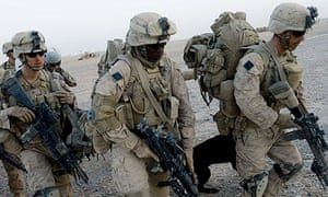 US marines prepare to board helicopters during Operation Khanjar in Helmand.