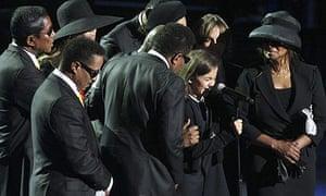Paris Jackson, Michael Jackson's daughter, cries during her father's memorial service.