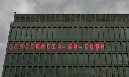 """A news ticker at the US mission in Havana reads """"Democracy in Cuba"""". The ticker has gone blank"""