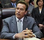 Arnold Schwarzenegger, California's governor, signs a $85bn compromise for the state's budget.