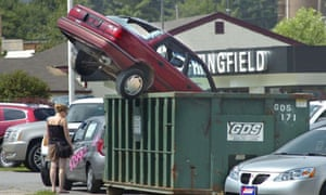 An auto dealer in Springfield, Vermont promotes the US government's cash for clunkers programme. Photograph: Vyto Starinskas/AP