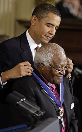 Archbishop Desmond Tutu is presented with the presidential medal of freedom by Barack Obama at the White House