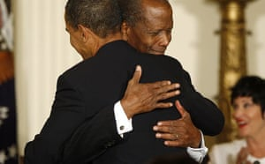 Barack Obama hugs actor Sidney Poitier after presenting him with the presidential medal of freedom at the White House