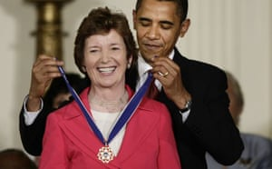 Barack Obama presents the medal of freedom to Mary Robinson, the former Irish president