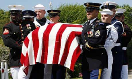 Members of the US military honour guard carry a casket containing the body of Edward Kennedy outside of the Kennedy compound
