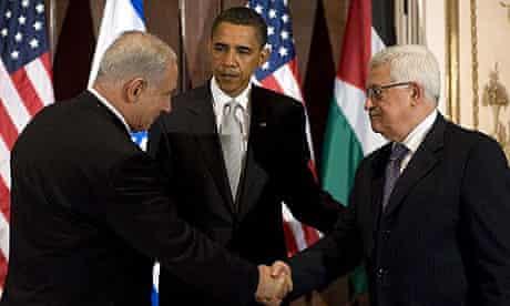 Benjamin Netanyahu, Israel's prime minister, and Palestinian leader Mahmoud Abbas shake hands while Barack Obama looks on at the Waldorf Astoria in New York. Photograph: Jim Watson/AFP