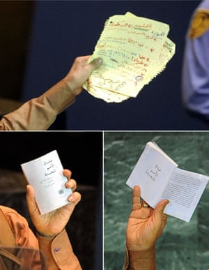 Muammar Gaddafi holds a stack of speech notes, top, and a copy UN charter during his speech at the UN general assembly