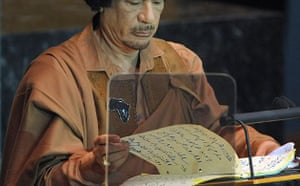 Muammar Gaddafi looks at his notes during his speech to the UN general assembly