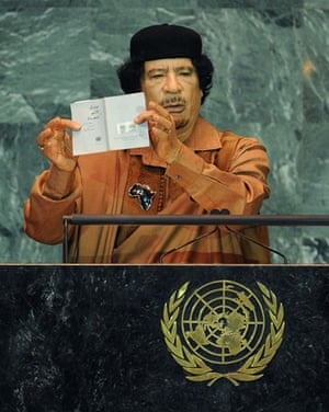 Muammar Gaddafi holds up a document during his speech to the UN general assembly