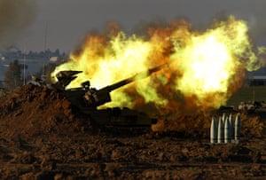 Gallery Gaza: An Israeli mobile artillery unit fires a shell towards Gaza