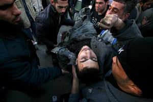 Gallery Gaza: Palestinians carry the body of Hamas militant