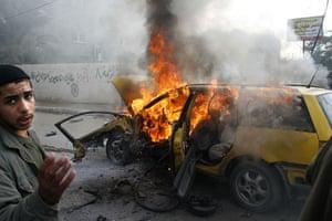 Gallery Gaza: A car burns following an Israeli air strike at the Rafah refugee camp