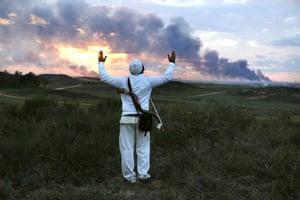 Gallery Gaza: An Israeli man recites a short prayer near Kibbutz Nir Am