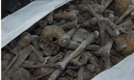 A bag containing human bones found in a mass grave in northern Poland
